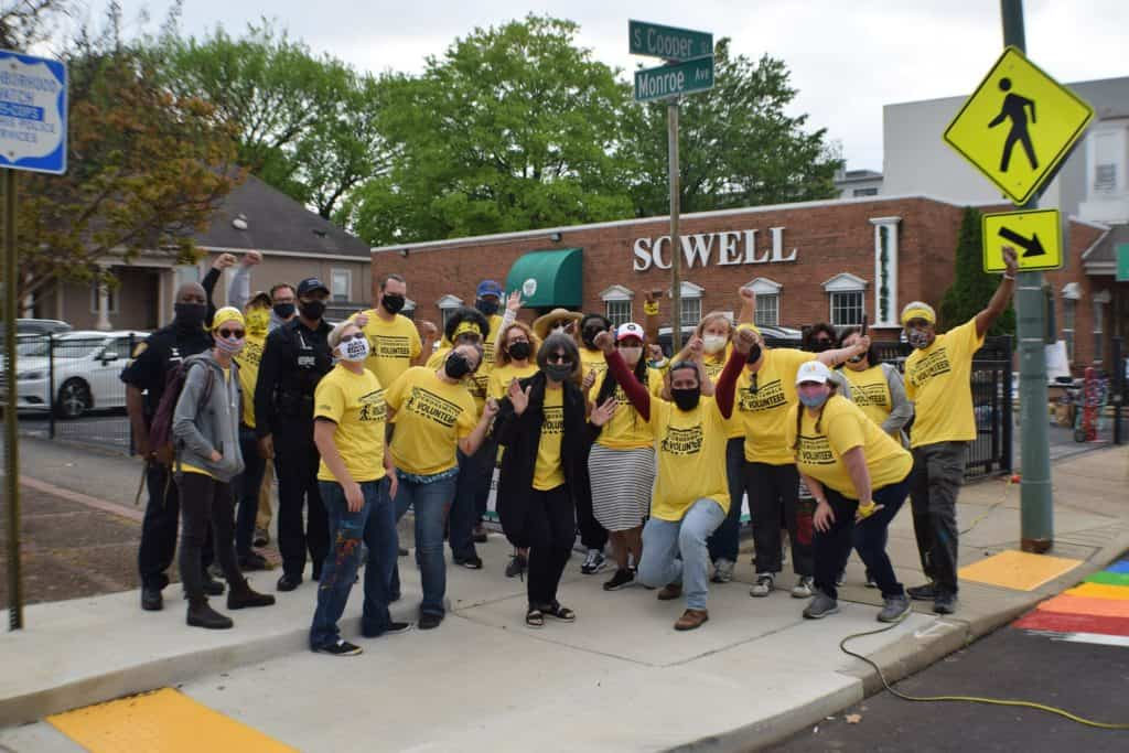 The volunteers cheered as the crosswalks were finished.