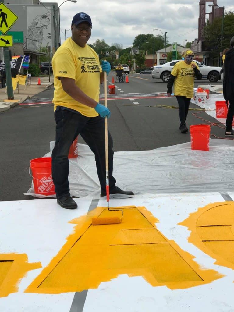 Memphis Commissioner Reginald Milton helped install the crosswalks.
